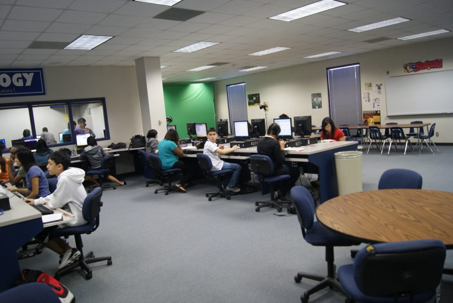 The crowded students are hard at work while they have the chance, because it is hard to find a computer with so many people.