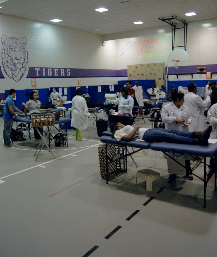 Students+and+teachers+gather+at+the+Kerr+gym+to+donate+blood+and+plasma.+