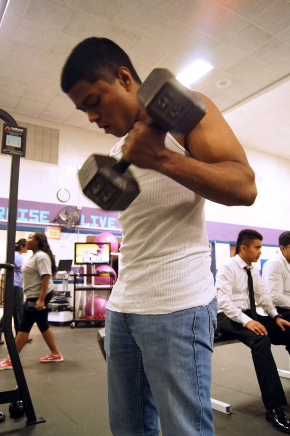 Junior Abhishek Mukund lifts weights as a way to unwind after taking a test.