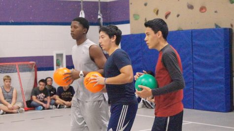 Sophomore Kenneth Onigbinde and seniors Peter Nino and Edwin Melgar prepare to defend their side of the court.
