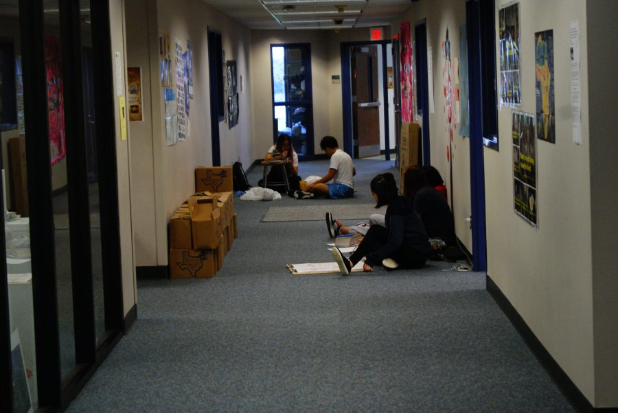 Art students work in the hallways due to insufficient space in the rooms.