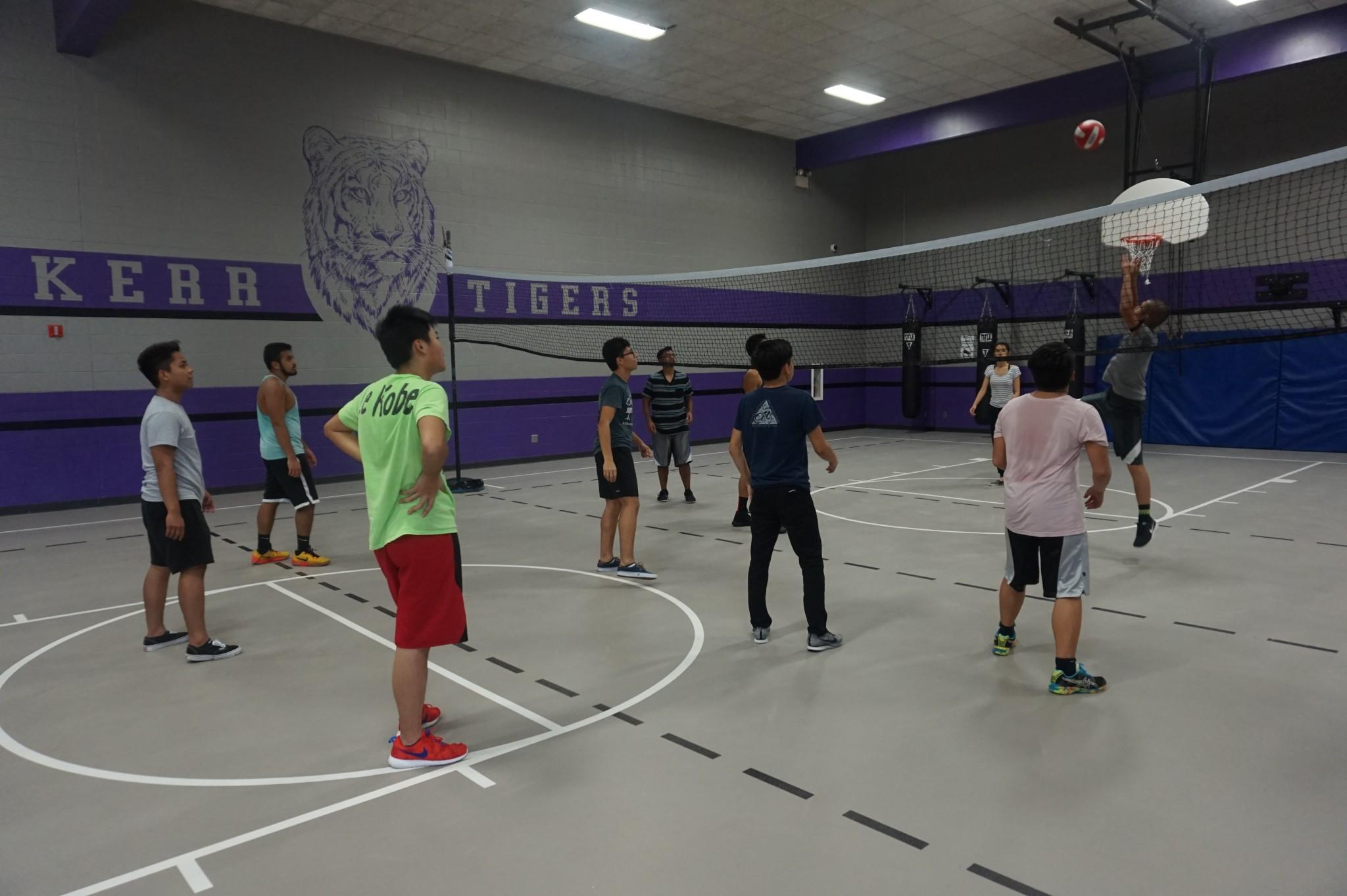 Gym students are seen here playing a friendly game of volleyball