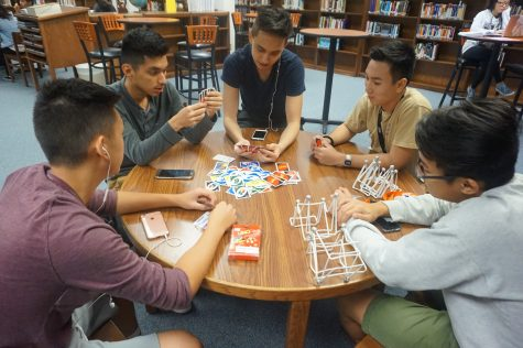 Left to Right: Justin Duong, Axel Soto, Jimmy Carter, Kevin Huynh and Tu Nguyen are seen playing a casual game of Uno.