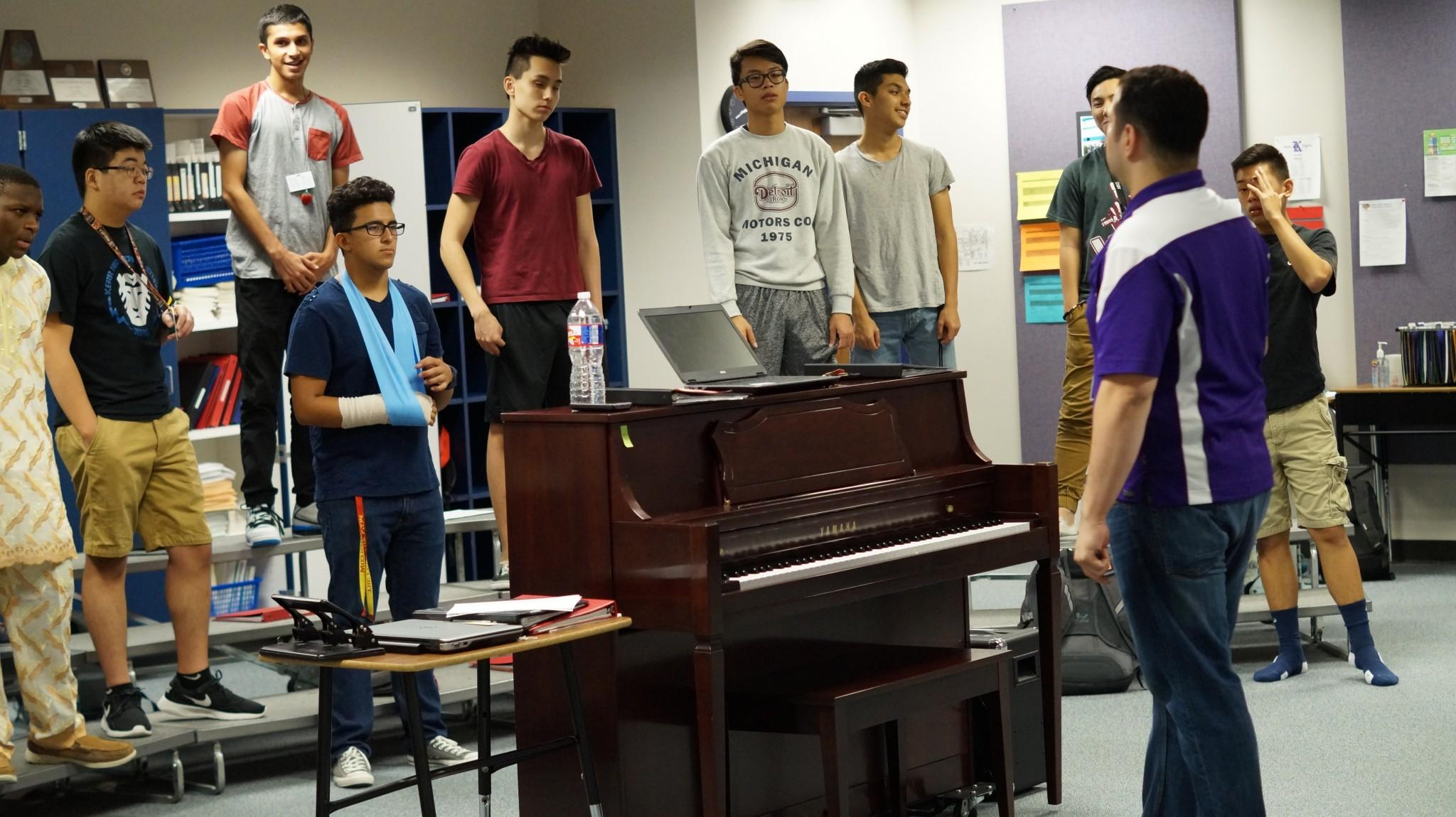 Choir Director Freddy Bonilla practices with the Men's Chorus.