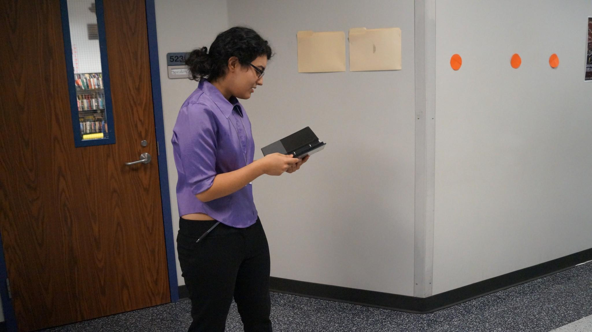 Speech and Debate member Maria Magana practices her piece for the upcoming tournament.