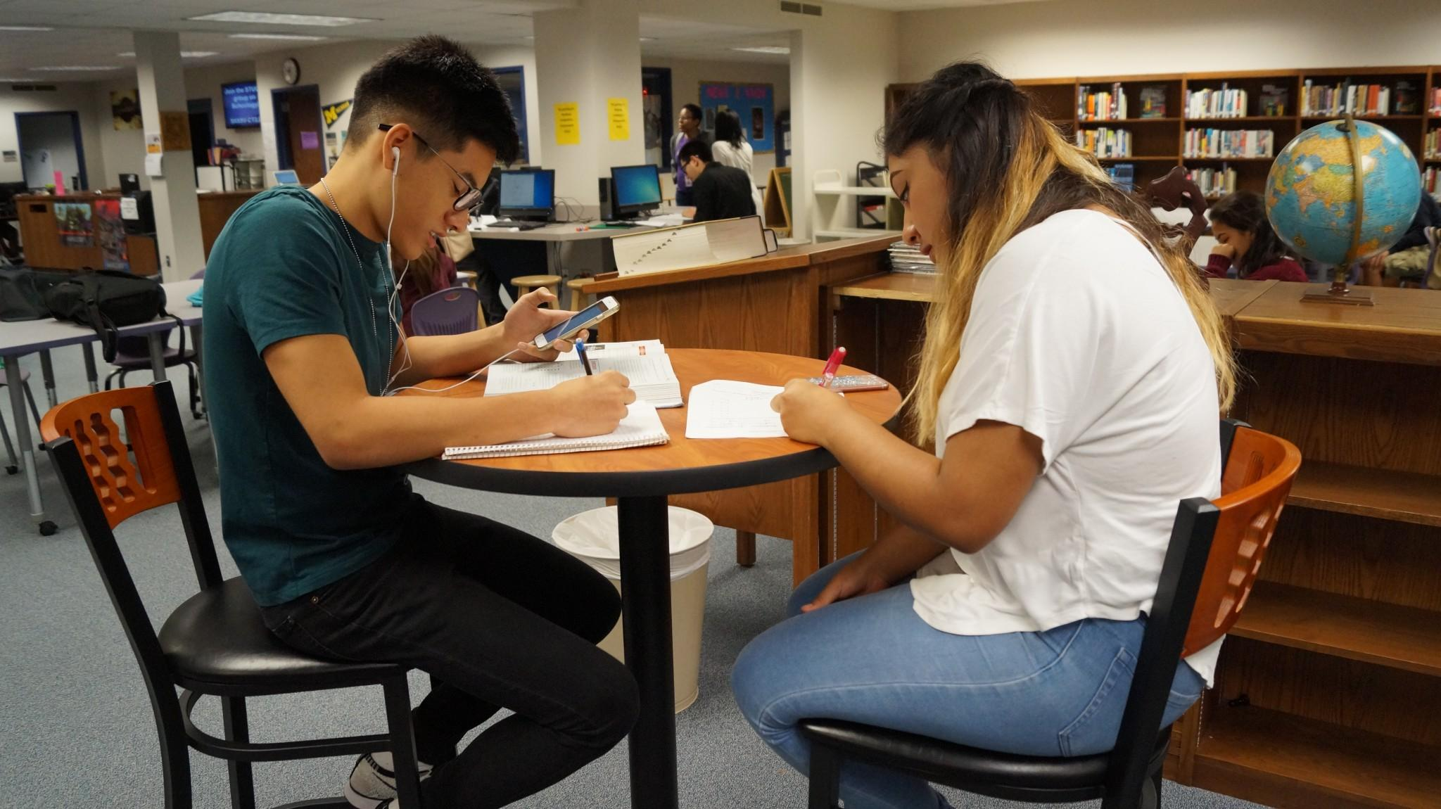Seniors Brian Phan and Michelle Martinez actively work on AP Statistics