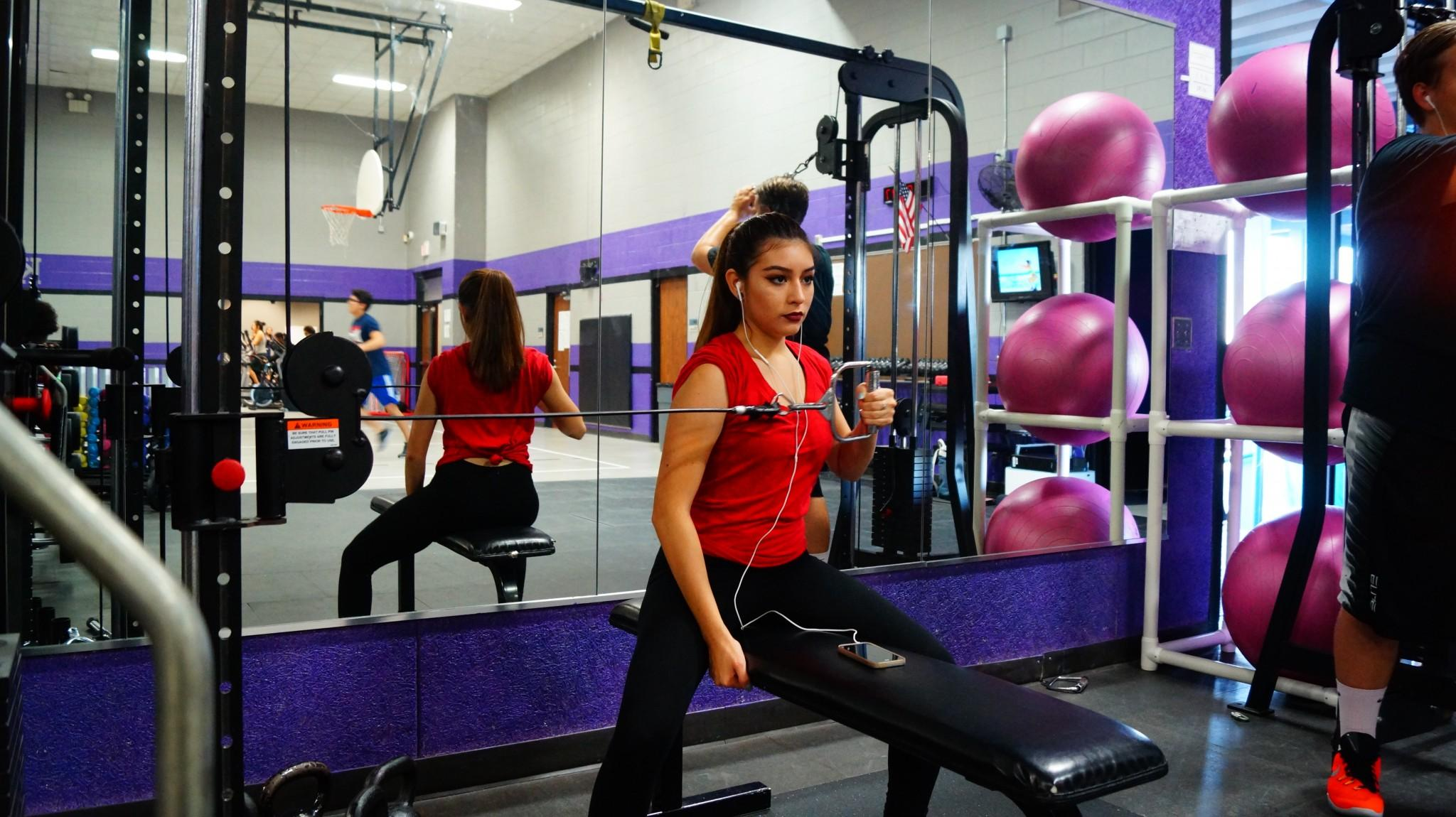 Kerr Fitness Club officer Maria Castillo engages in a rigorous workout.