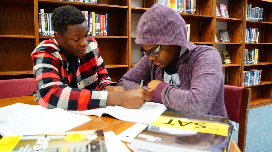 Senior Chandler Clark helps junior Kurtis Deschamps with SAT preparation.