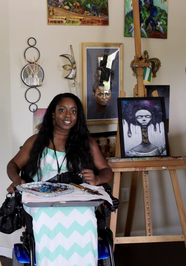 Artist and alumna Kemi Yemi-esse with her art pieces.