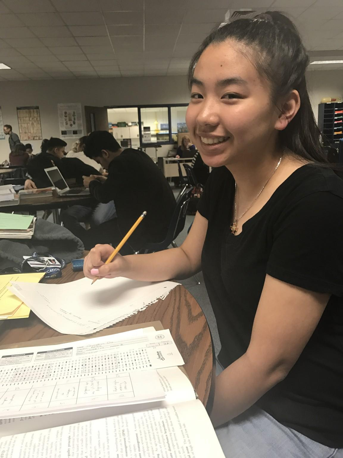 Junior Quynh Do working on test corrections during her AP Environmental Science class.