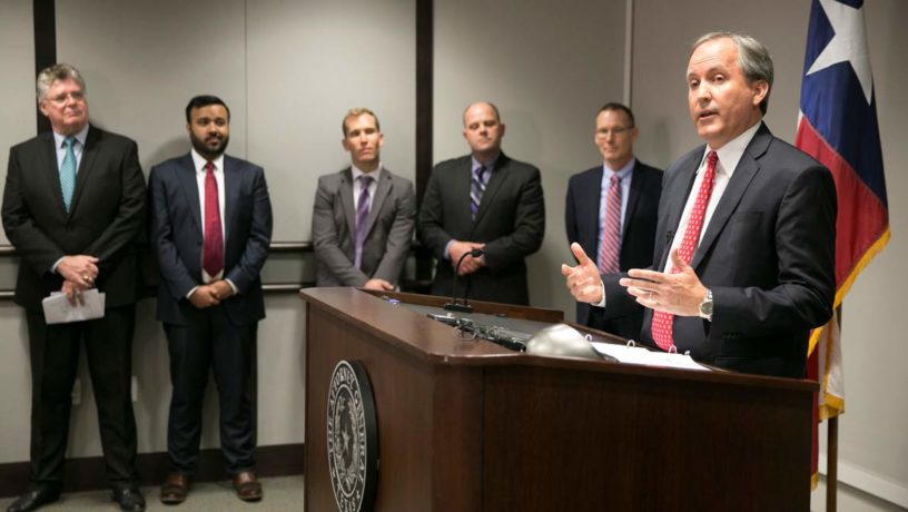 Texas Attorney General Ken Paxton (right) speaks out during a press conference regarding how schools should deal with student bathroom concerns. Photo Credit: Associated Press