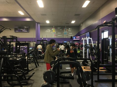 Students work out in the weights section of the Gym.