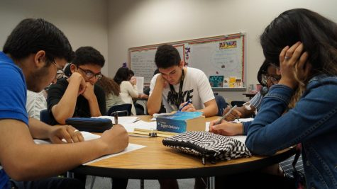Students study in the social studies center.