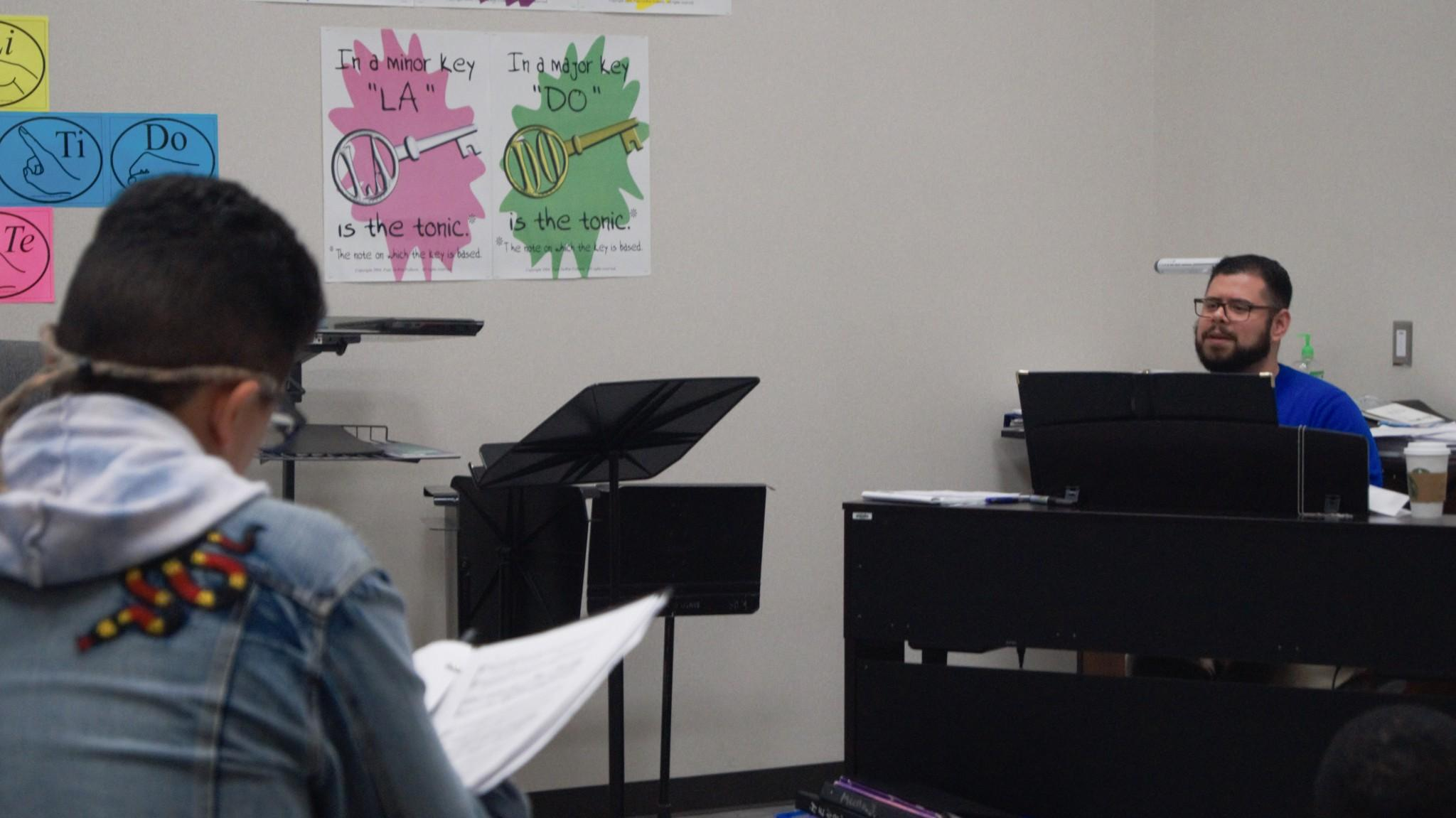 Mr. Bonilla is working with his students to sing their songs, too.