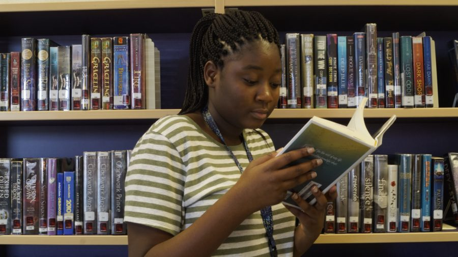 Sophomore+Souraya+Amirou+says+her+New+Year%E2%80%99s+resolution+is+to+read+more+books.+She+is+reading+This+Is+Not+The+End+by+Chandler+Baker+in+the+library.