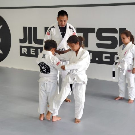 Moon Kim works with students at Reign Jiu-Jitsu in Katy.