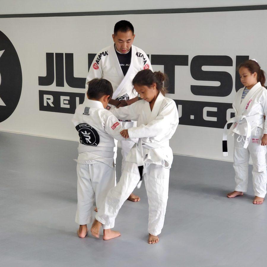 Moon Kim works with students at Reign Jiu-Jitsu in Katy.