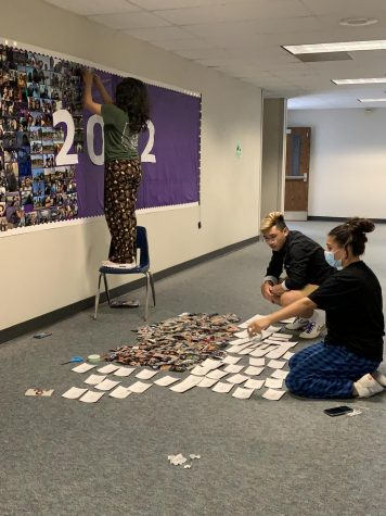 Seniors assemble the memory wall outside the library